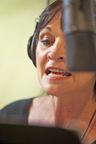 Voice Over Actor Katherine Brown working behind the Neumann U-87 Microphone at SunSpots Orlando Studios