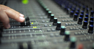SunSpots Engineer Xavier Huix mixes on his control room console.